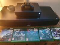 Xbox One X plus 5 games.