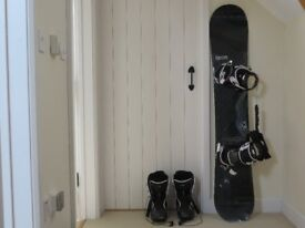 Matched set of Salomon snowboard, bindings and boots, in Snow and Rock padded bag