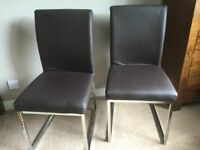 Dining Chairs (4) Deep brown Faux with chrome legs in a sleigh leg design (see pictures)