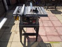 """a 10"""" table saw on its stand"""