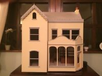 HAND BUILT VICTORIAN DOLLS SHOP AND HOUSE . PAINTED AND DECORATED WITH LIGHTS AND ACCESSORIES.