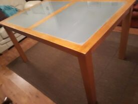 wooden dinning table with tempered glass on the top