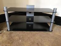 Black solid glass TV stand, quick sale at only £20, first to see it buys