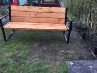 A modern bench with a backrest