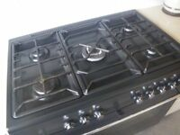 DUEL FUEL RANGE COOKER. 5 X GAS RINGS; LARGE FAN ASSISTED OVEN. BLACK. IN VERY GOOD CONDITION.