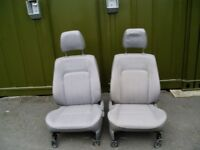 two grey front seats to fit mazda b2500 pickup or ford ranger in good condition