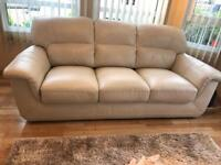 Three seater sofa with arm chair.