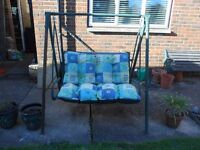 Garden swing seat with cushions in Hertford, Herts