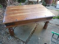 Mahogany and hard wood coffee table with iron fittings