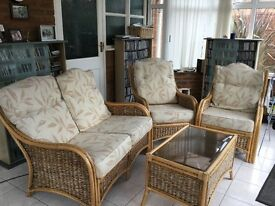 Conservatory rattan chairs and glass coffee table