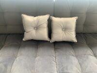 2 small silver cushions