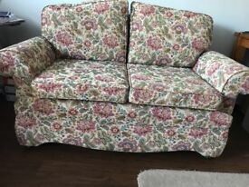 Sofa with fold down arms, creating a single bed, great condition.