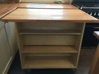 Beech solid top island unit On casters so can be moved easily