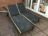 Solid wood sunloungers with canvass seating