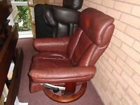 Brown leaher swivvel chair with foot rest good condition