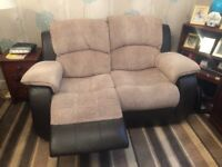 Cream and brown leather recliner sofa