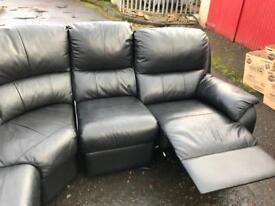 Corner suite, reclining in black leather