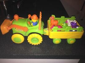 Farm tractor and trailer with animals