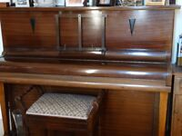 Lister upright piano, with piano stool.