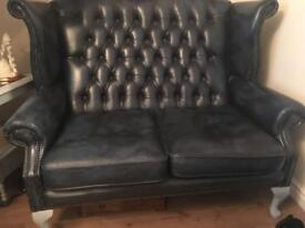 Chesterfield sofa and wingback chairs