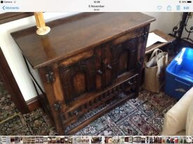 Beautiful carved vintage solid oak cupboard with 2 doors and a drawer