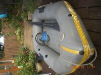 Inflatable boat 2.5m. Complete with boards, outboard bracket, oars, pump and inflatable seat.