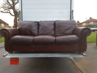 Set of two seater and three seater leather brown sofas with matchin footstool