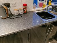 Kitchen worktop and sink with taps