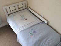 white ikea bed including mamas and papas bedding set plus curtains and ties