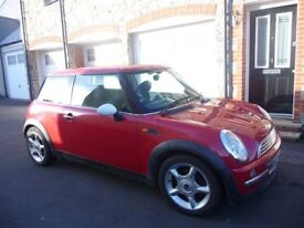 Fabulous Red BMW Mini Cooper. Recent new clutch. Great drive. No dents or marks. Good Condition.