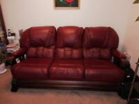 Leather 3 seater sofa and 2 arm chairs for sale colour maroon and oak. Brilliant condition