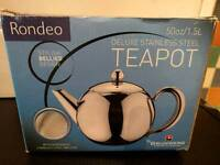 Brand new stainless steel teapot in box