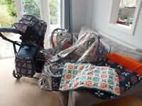 Cosatto Giggle 2 travel system- pushchair, carrycot, carseat, footmuff & raincovers bought for £450