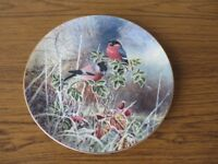 A set of four Coalport limited edition 'frosty mornings' wall plates