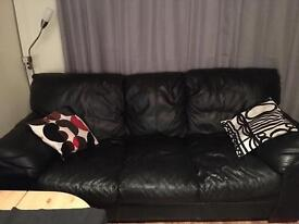 Black lather sofa with 2 armchairs