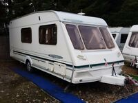 2002 Abbey Freestyle 520SE 4 Berth Side Dinette End Washroom Caravan with Full Awning