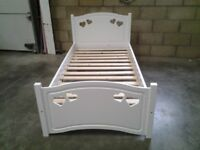 Ex display White single bed frame with heart detail. Very good. Bargain. Delivery available.