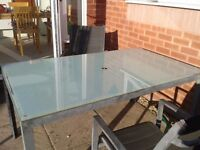 Garden table with glass top seats 6