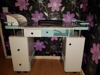 The nail bar is in really good condition. Its got a marble top and lots of storage.