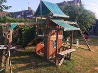 Playhouse and swings