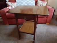 mahogany effect table, with extending wings, drawer and wheels - FREE!