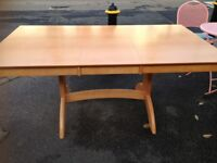 EXTENDING BEECH SOLID WOOD TABLE GOOD CONDITION APART FROM A COUPLE OF MARKS NOTHING DRASTIC , MEAS