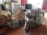 collectors Teapots,3 big ones 3 middle ones and 2 little ones.