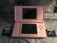 Pink Nintendo DS comes with charger choice of games can be added