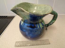 Blue glazed jug hand made