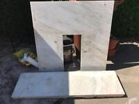 Marble hearth and fireplace backplate