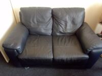 Black leather effect sofa