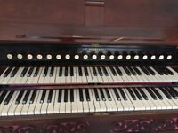Estey reed organ, two manual with foot pedals and electric pump
