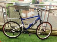 Apollo Outrider Bike in blue and white in very good condition and ready to ride it away