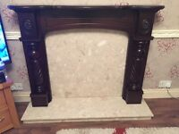 Mahogany wood fireplace with matching marble hearth and back plate